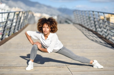 2300806-young-black-woman-doing-stretching-after-running-outdoors-photocase-stock-photo-large